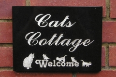Cats welcome house sign