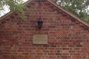 Customer picture. York stone house name sign set into brickwork in gable end of building. The customer set the stone back slightly into a recess for a very professional look.