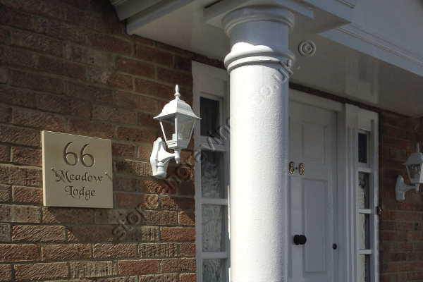 Customers photo: Cream sandstone house sign in Chancery font. The sandstone plaque screw fixed to the wall.