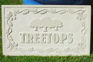 Custom design carved in-relief house sign. Yorkstone with Oak leaf border and Oak tree stand artwork engraved.