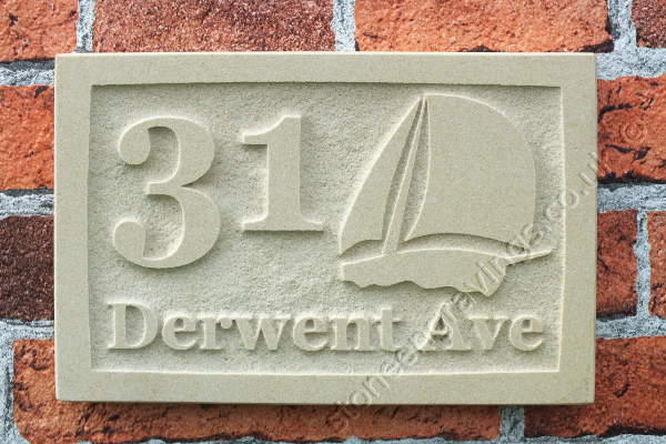 Custom designed York stone house sign carved in-relief. The font is engravers Times the Yacht motif drawn up for this job.