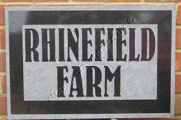 Rhinefield Farm, , black granite house sign carved in-relief with Bernhard Font.
