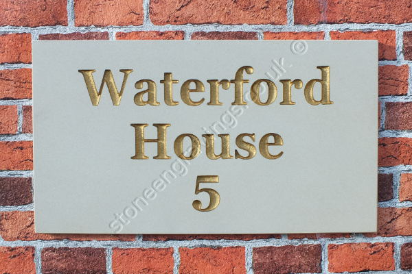 Waterford House sandstone house sign. Engravers Times font painted gold.