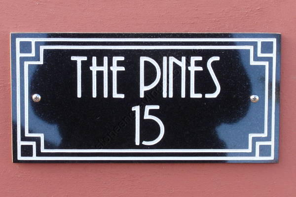 The Pines, Art-Deco style house sign. Black granite with art-deco border and lettering engraved and finished white. The font is Andes.
