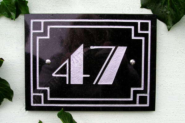 No. 47, Art-Deco style house sign. Black granite with art-deco border and lettering engraved and finished silver. The font is Broadway.
