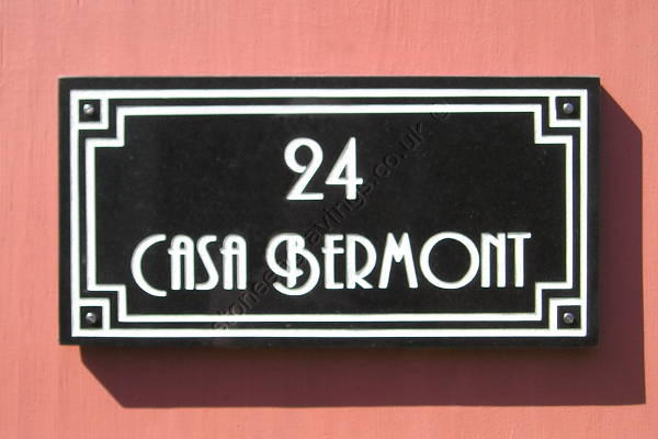 Casa Bermont, Art-Deco style house sign. Black granite with art-deco border and lettering engraved and finished white. The font is Andes.