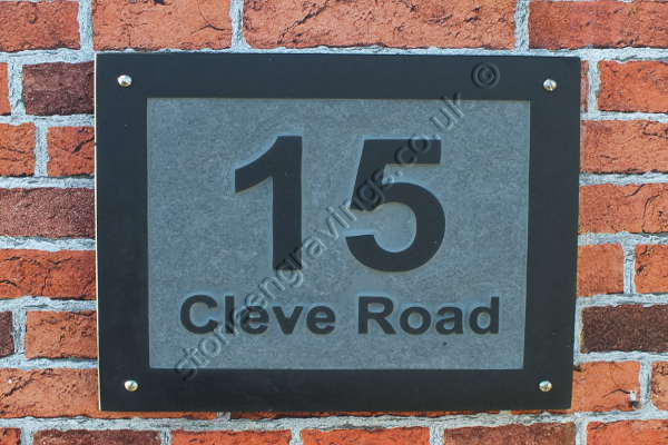 "Street name and number sign. ""Cleve Road"". Welsh slate carved in-relief. Arial bold font."