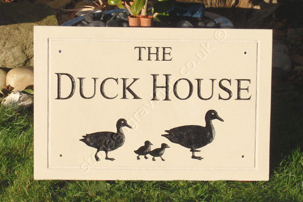 The Duck House sign in sandstone. Duck family engraved and painted black. Custom font.