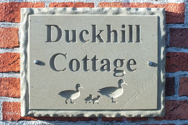 "York Stone house name sign. With ""Rockborder"" edge, screw fixed. font Times Roman Bold. Finished with the Duck Family artwork."
