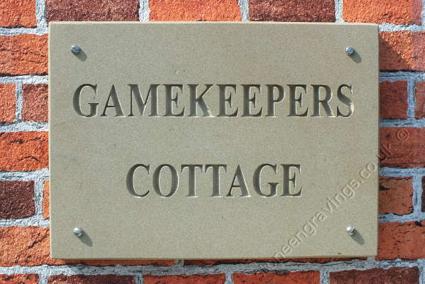 "York stone house sign. House name, ""Gamekeepers Cottage"" in Times Roman bold uppercase font. fixed on hidden pins."