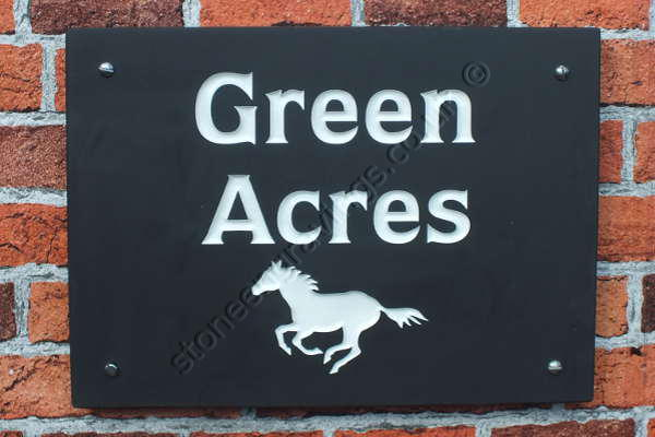 Green Acres house sign in Welsh slate. Pony running motif and Quorum font . Engraved and filled white.