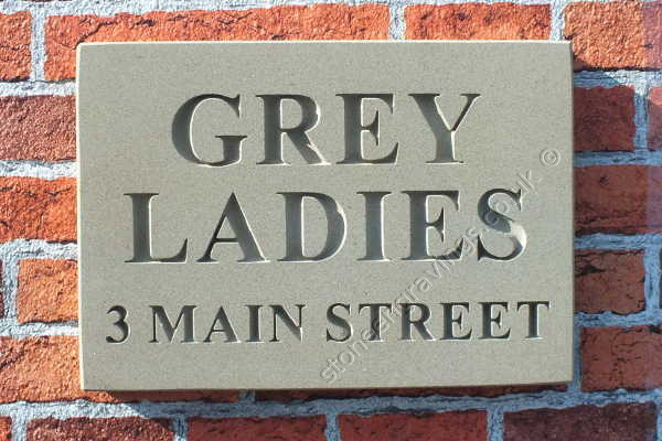 York stone house sign. House name and street name in Times Roman bold uppercase font. fixed on hidden pins.