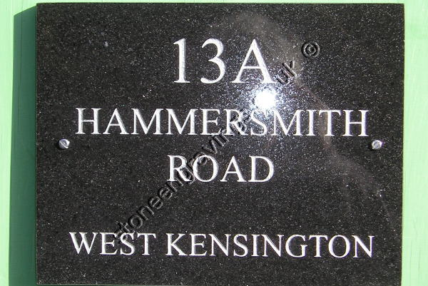 Hammersmith Road house sign in Black Absoluto granite Times Roman font engraved and finished silver.
