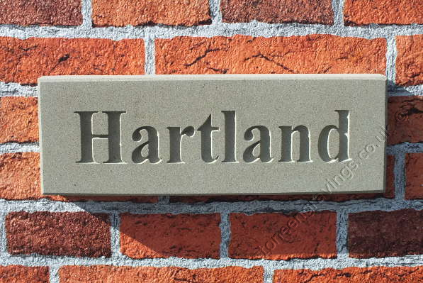 "Classic York stone house sign. House name ""Hartland"" in Times Roman bold title-case font. fixed on hidden pins."