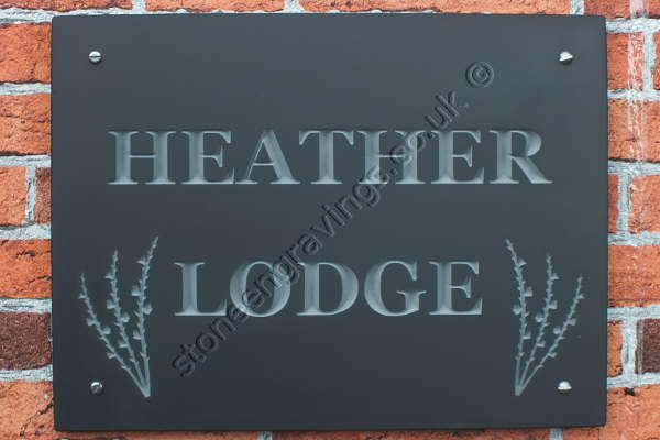 Heather Lodge welsh grey slate house sign. Times Roman bold font with heather sprigs motif.