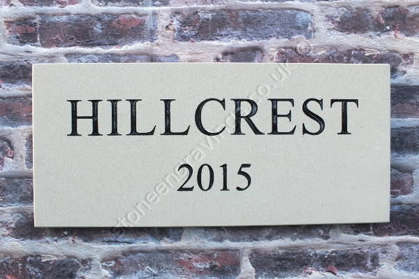 HILLCREST cream sandstone house sign. Times Roman standard font painted black.