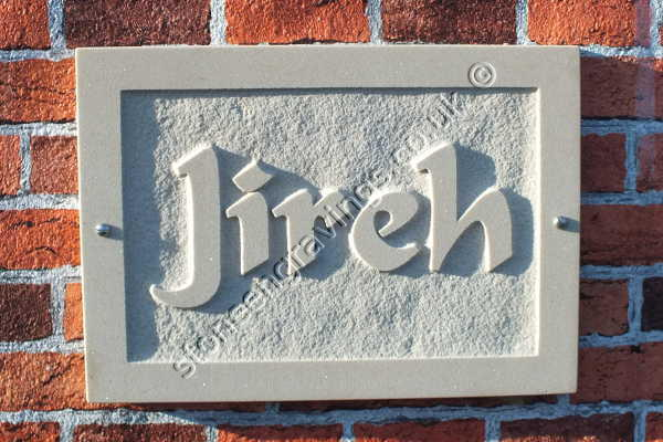 "Jirah house sign in cream Indian sandstone. Carved in-relief. The font is ""Flat Brush""."