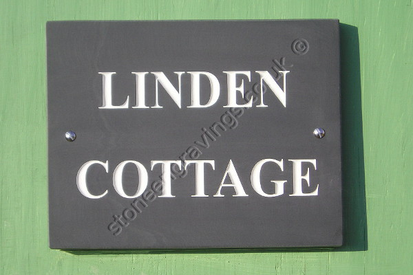 Lindens Cottage, house sign in Welsh slate. Font Times Roman, lettering highlighted in white.