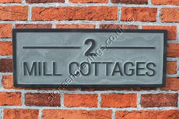 "Mill cottage house sign in Welsh slate carved in-relief. The font is ""Arial standard""."