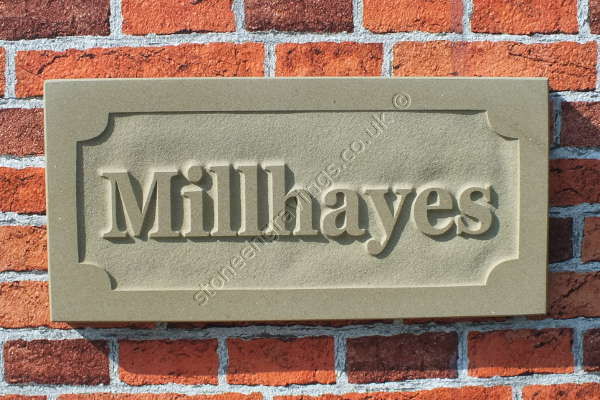 "Carved in-relief house sign. York stone with scallop panel. ""Millhayes"" in Baskerfield"" Font. fixed on hidden pins."