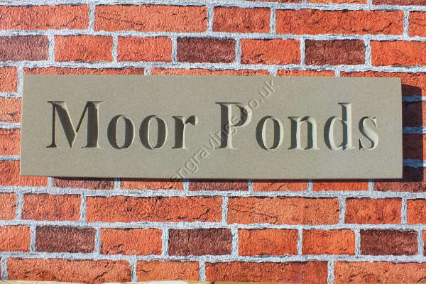 "Classic York stone house sign. House name ""Moor Ponds"" in Times Roman bold font. fixed on hidden pins."