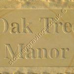 Oak Tree Manor york stone rockborder house sign. Times Roman Bold font.