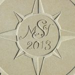 Compass centre boss personalised with initials and date
