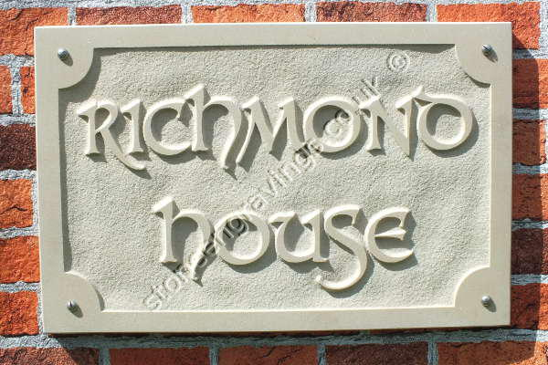 "Richmond house sign in cream Indian sandstone. Carved in-relief. The font is ""Dolphin uppercase""."