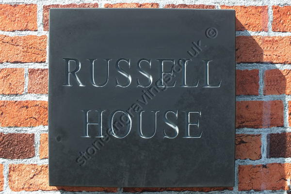 RUSSEL HOUSE, house sign in Welsh slate. Font Times standard, lettering left natural (unpainted).