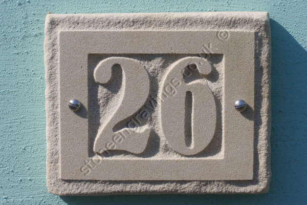 "House number. Indian cream sandstone""rockborder"" Number carved in-relief. Font Bernhard."