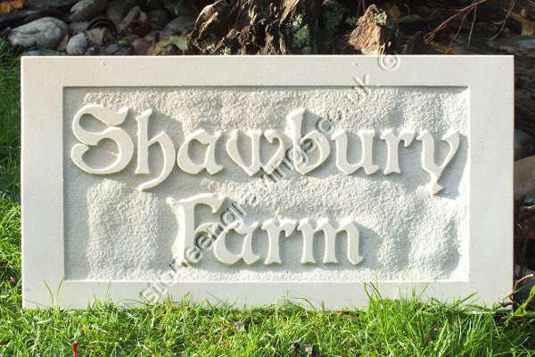 "Shawbury Farm house sign in cream Indian sandstone. Carved in-relief. The font is ""modified Boister""."