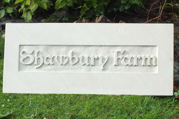 "Shawberry Farm house sign in cream Indian sandstone. Carved in-relief. The font is ""modified Boister""."