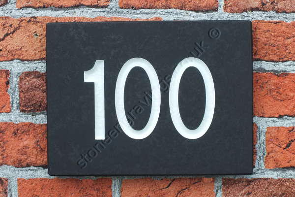 House number sign. Welsh slate classic design. Arial font highlighted white. Supplied on 10mm slate for glue fixing.