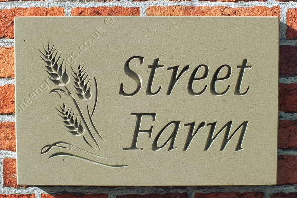 "Street Farm. York stone house sign with Barley motif. The font is ""Dolphin""."