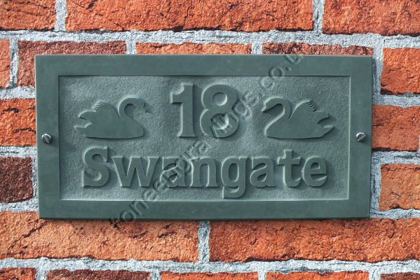Green slate house name and number sign. Carved in-relief with Swan motif.