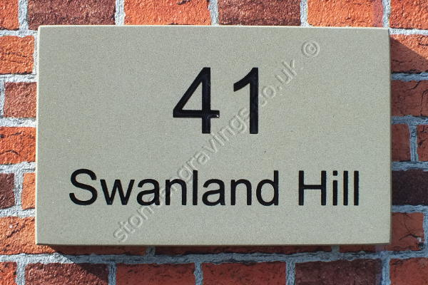 "41 Swanland Hill. Lettering engraved and black painted. The font is ""Arial standard""."