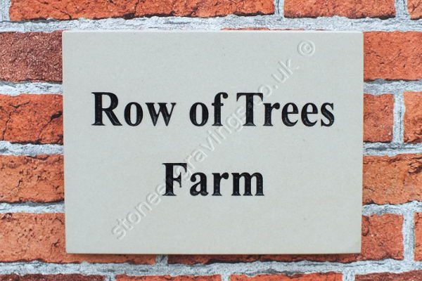 Row of Trees Farm cream sandstone house sign. Times Roman font painted black.