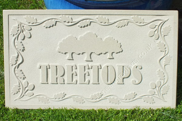 Custom designed, York stone carved in-relief. Treetops in Bernhard font. Oak trees and oak leaf border.