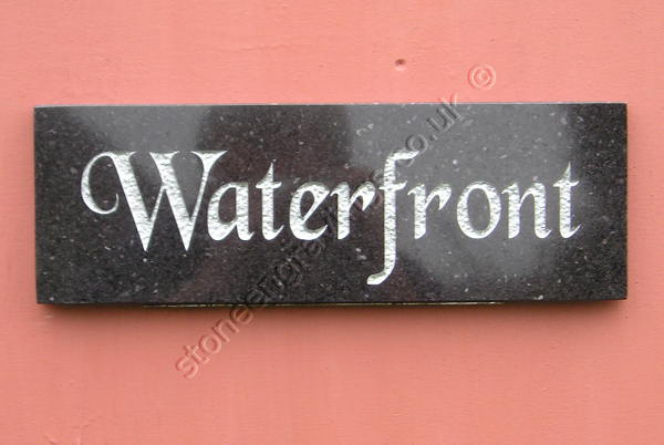 Waterfront house sign in Black Absoluto granite Chancery font engraved and finished silver.