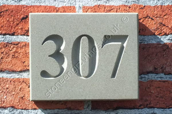 "House number. York stone ""Classic style"" Number deep incised. Font Times Roman. Fixed on single hidden pin."