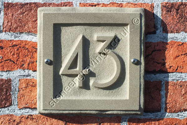 "House number. York stone ""rockborder"" Number carved in-relief. Font Andes art-deco."