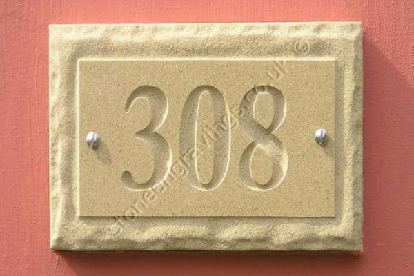 """York Stone number sign. With """"Rockborder"""" edge, screw fixed. Number in Times Bold."""